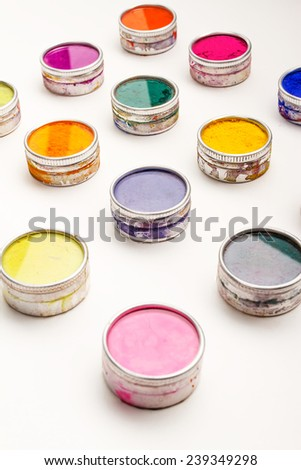 Vivid Indian Holi festival colours on a white background - stock photo