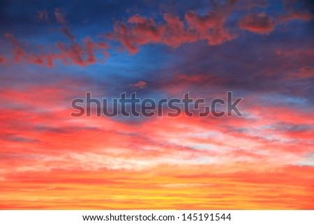 Vivid sky illuminated by the sunset - stock photo