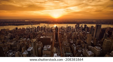 Vivid sunset over New York taken from the Empire State Building  - stock photo