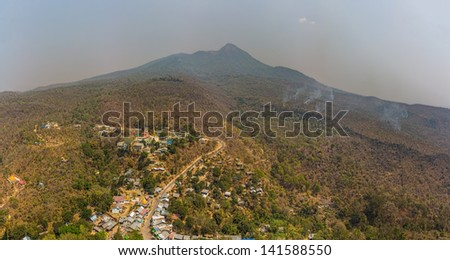 Viwe from Popa Taungkalat monastery atop an outcrop of Mount Popa volcano, Myanmar. - stock photo