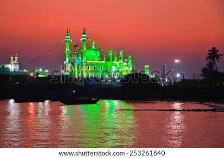 VIZHINJAM, INDIA - FEBRUARY 1, 2015:  Vizhinjam Juma Masjid is situated at the edge of a cliff overlooking the Arabian Sea near Kovalam beach. - stock photo