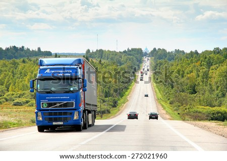 VLADIMIR REGION, RUSSIA - AUGUST 26, 2011: Blue semi-trailer truck Volvo FH12 at the interurban freeway. - stock photo
