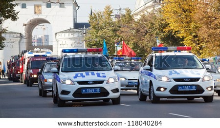 VLADIMIR, RUSSIA - SEPTEMBER 15: City Day  event September 15, 2012 in Vladimir, Russia.  Police car in carnival procession  dedicated to the 1022 anniversary of Vladimir city - stock photo