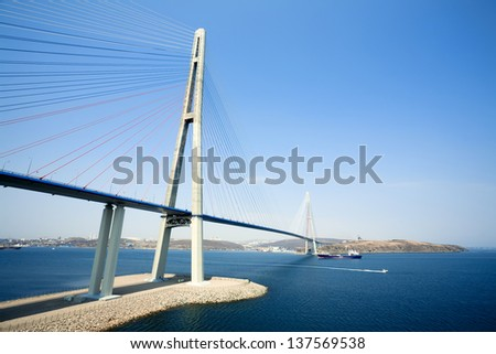 VLADIVOSTOK - APRIL 28 : cable-stayed bridge to Russian Island , on april 28, 2013, Vladivostok. Russia. Vladivostok is the largest port on Russia's Pacific coast and the center of APEC Forum '2012. - stock photo