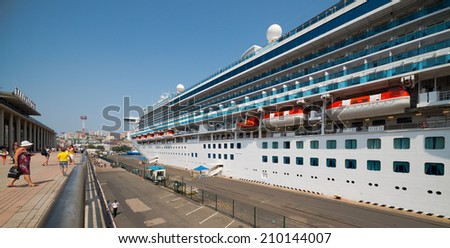 VLADIVOSTOK, RUSSIA - AUGUST 9, 2014:  The gem class cruise ship Diamond Princess docks at Vladivostok harbor. Diamond Princess is a Grand-class cruise ship that entered service in March 2004.