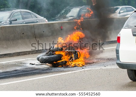 VLADIVOSTOK, RUSSIA - August 02, 2013: Traffic accident between a car and a motorcycle, after crash the motorcycle has been embraced with fire.
