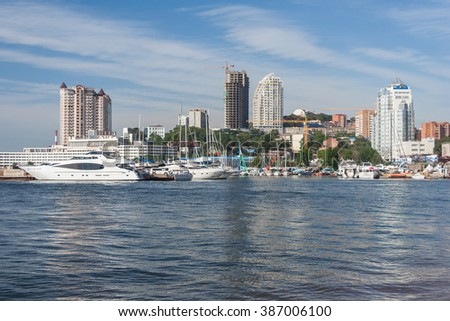 Vladivostok, Russia - circa August 2014: Sailing boats and high rise residential buildings in Vladivostok, Russia