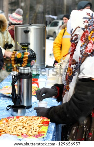 VLADIVOSTOK, RUSSIA-FEB. 26: Celebration of Maslenitsa. Russian holiday. Russian samovar, people drink tea. Feb. 26, 2012, Vladivostok, Russia. Maslenitsa. Traditional russian holiday - Maslenitsa.