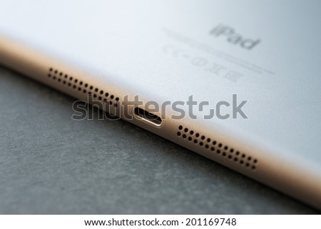 VLADIVOSTOK, RUSSIA - JUNE 4, 2014: Apple Lightning Connection port on Ipad mini. Is a proprietary conniction used to connect mobile devices such as iPhones, iPads or iPods to computers.   - stock photo