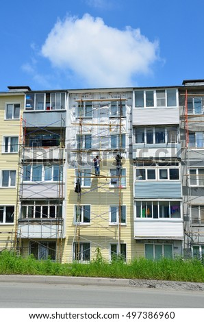 Vladivostok, Russia, June, 01, 2016. Repair and restoration work of a typical five storey building