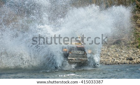 "Vladivostok, Russia - may 1, 2014: Suzuki Jimny cars, motorcycles, Enduro and ATV, go off-roading in five-day race ""Russian rally 2014"""