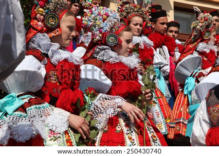 VLCNOV, CZECH REPUBLIC - MAY 26, 2013: Young women dressed in traditional Moravian folk costumes attend the Ride of the Kings folklore festival in Vlcnov, South Moravia, Czech Republic. - stock photo