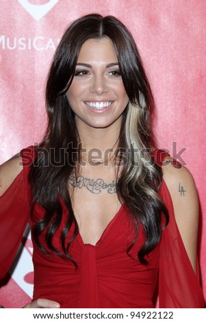 vLOS ANGELES - FEB 10:  Christina Perri arrives at the 2012 MusiCares Gala honoring Paul McCartney at LA Convention Center on February 10, 2012 in Los Angeles, CA - stock photo
