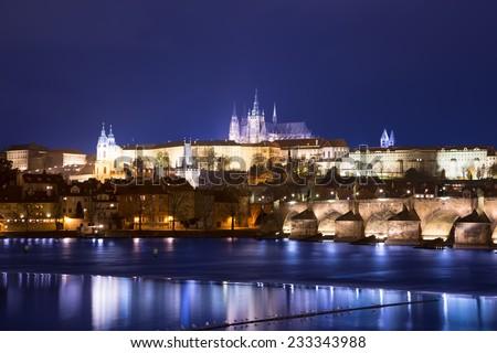 Vltava river, Charles Bridge (Stone Bridge, Prague Bridge)  and St. Vitus Cathedral at night. Prague. Czech Republic - stock photo