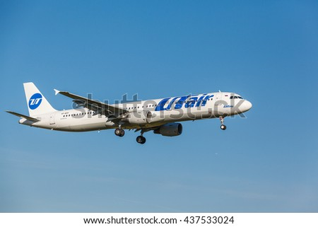 VNUKOVO, MOSCOW REGION, RUSSIA - 02 July, 2013: Airplanes at Vnukovo international airport. Utair Airlines A321 landing on runway - stock photo