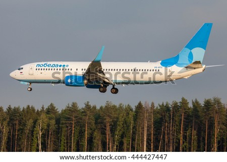 VNUKOVO, MOSCOW REGION, RUSSIA - JUNE 27, 2016: Airplanes at Vnukovo international airport. Pobeda Airlines Boeing 737-800 landing at Vnukovo airport