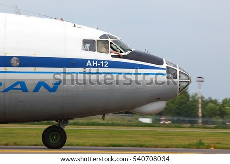 VNUKOVO, MOSCOW REGION, RUSSIA - JUNE 24, 2011: Antonov An-12 RA-12990 of Atran airlines taxiing at Vnukovo international airport.