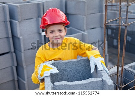 Vocational guidance concept - boy at construction site - stock photo