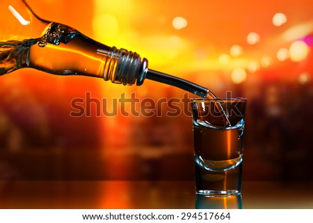 vodka in bar on a glass table - stock photo