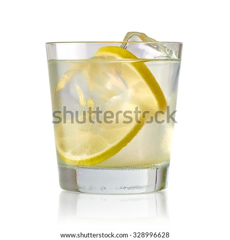 Vodka lime, gimlet or gin tonic with ice in glass on white background  - stock photo