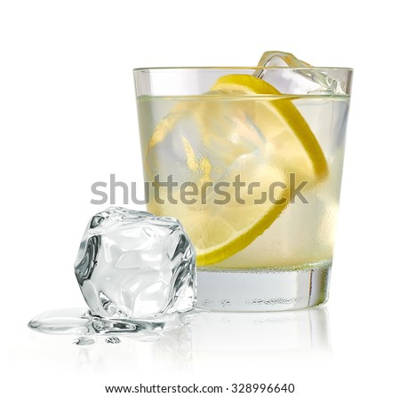 Vodka lime, gimlet or gin tonic with ice in glass on white background including clipping path
