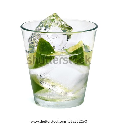Vodka lime with ice in glass on white background including clipping path - stock photo