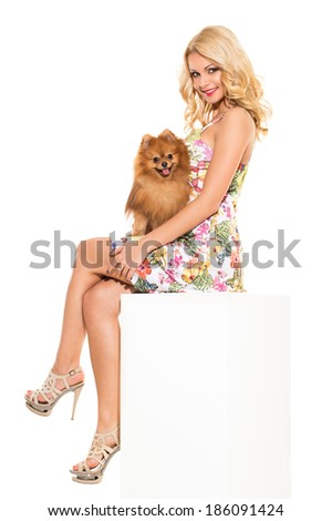 Vogue. Attractive girl with dog on a white background - stock photo