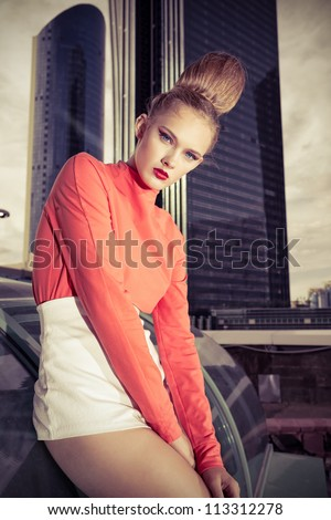 Vogue model posing over big city background. - stock photo