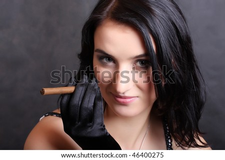 Vogue portrait of elegant smoking woman.  Low key studio shot. Great for calendar.