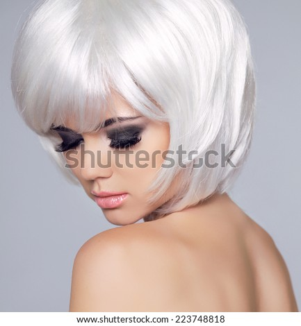 Vogue Style Beauty Fashion Girl Model Portrait. Eye makeup. Haircut. Hairstyle. Hairdressing. Fringe. Beautiful Woman with Short Blond hair. - stock photo
