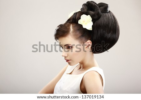 Vogue Style. Classy Charismatic Woman with Trendy Luxurious Hairstyle. Allure - stock photo