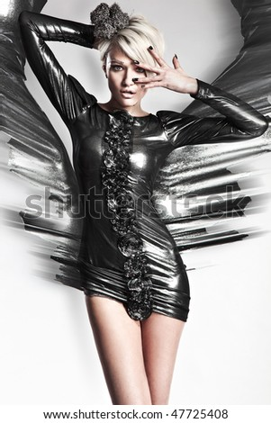 Vogue style photo of a young blond beauty - stock photo