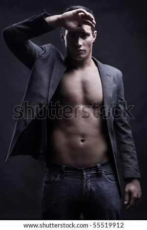 Vogue style photo of a young man - stock photo