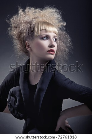 Vogue style portrait of a woman with modern hairstyle - stock photo