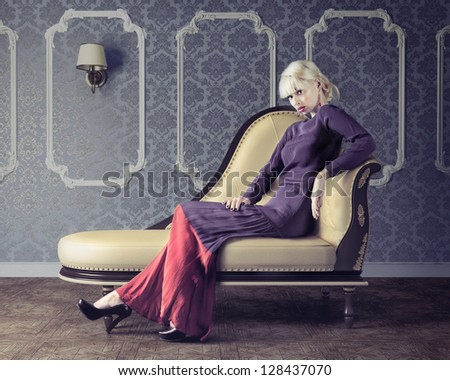 Vogue style sensual portrait of beautiful woman in dim light - stock photo