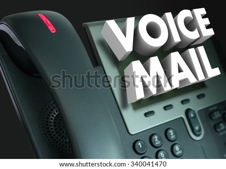 Voice Mail words in white 3d letters on a telephone to illustrate a recorded message or greeting - stock photo