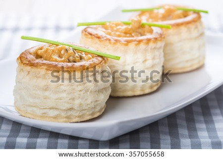 vol au vent stuffed with seafood cream and decorated with a steam of parsley - stock photo