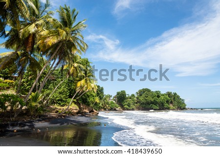 volcanic black sanded beach of Bananier, well known surf spot, Guadeloupe