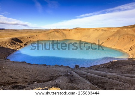 Volcanic crater with the lake inside near Krafla in Northern Iceland - stock photo