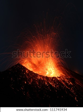 Volcanic Eruption. Active volcano Stromboli in Italy erupting  day and night every 20 minutes emitting dust, sand, ash and lava and lots of  toxic gasses
