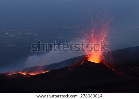 Volcanic eruption at sunset. Eruption of Mount Etna summer 2014.