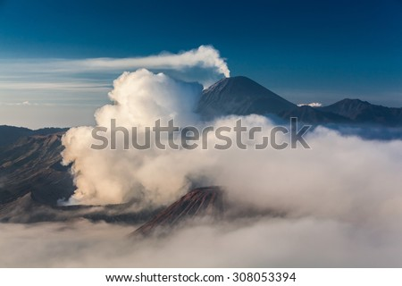Volcanic landscape in Bromo Tengger Semeru National park on foggy morning - stock photo