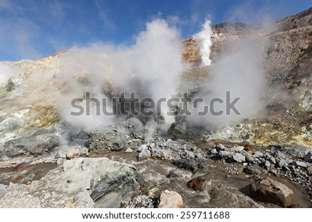 Volcanic landscape of Kamchatka: brimstone and fumarole field in crater of active volcano. Russia, Far East, Kamchatka Peninsula - stock photo