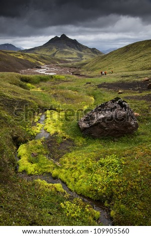 Volcanic peak with mossy foreground - stock photo