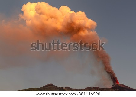 volcanic plume of Mount Etna at the dawn of October 26, 2013 - stock photo