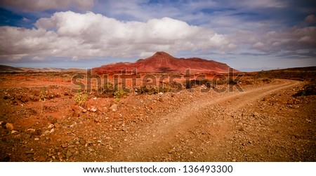 Volcanic scenery with red mountain - stock photo