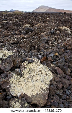volcanic stone in los volcanes lanzarote  spain  timanfaya  rock  sky  hill and summer  - stock photo