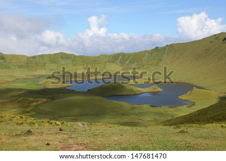 Volcano crater with a lake on the island of Corvo Azores Portugal - stock photo