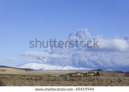 Volcano Eruption in Iceland Ash and blue Sky - stock photo