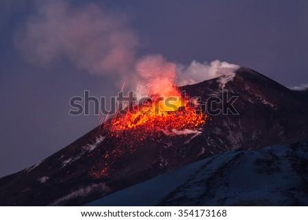 Volcano eruption. Mount Etna erupting from the crater Voragine  - stock photo